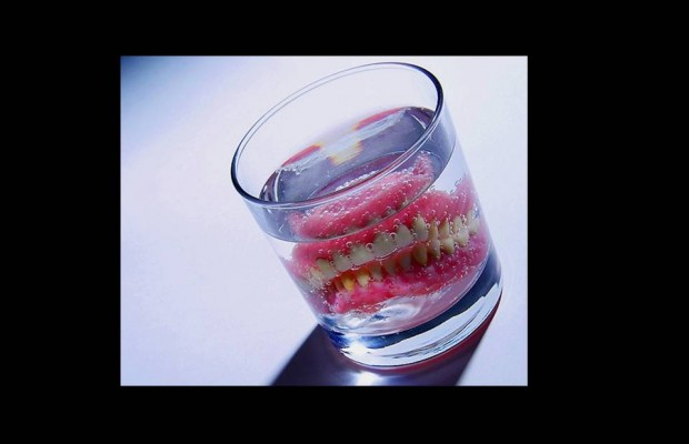 A woman hides 3 rocks of crack in her dentures